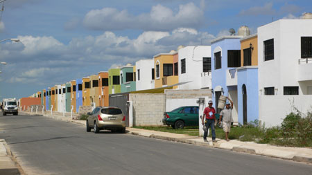 homes of paraiso maya, workers and the garbage truck in the distance.