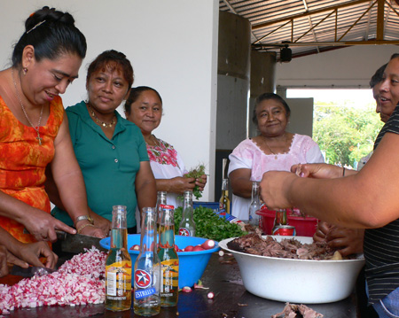 women preparing for the tacos
