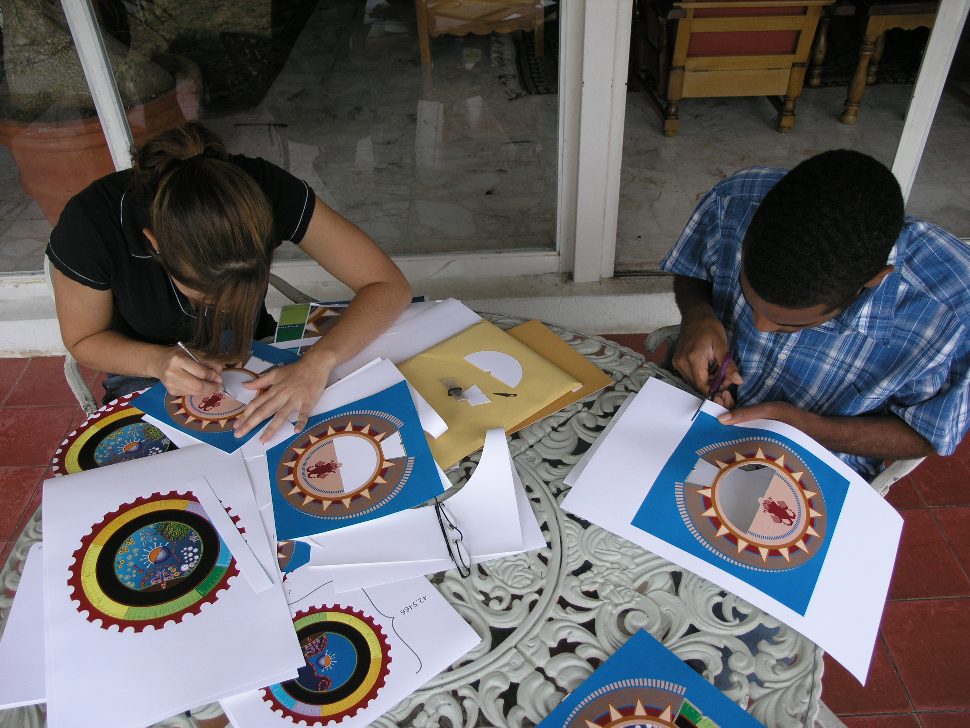 Designing Time, photograph of designers working on Wixárika Calendar Prototype
