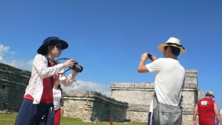Photos of tourists taking photos at Tulum